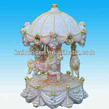 Pink polyresin merry-go-round music box
