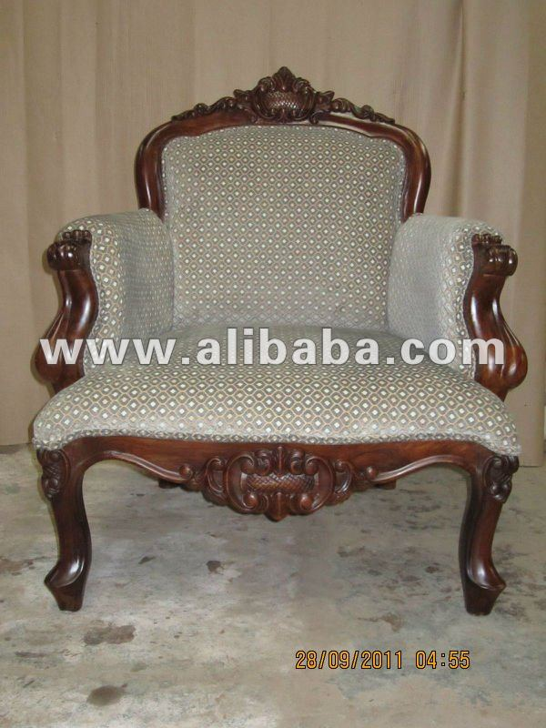 HANDCARVED WOODEN SOFA WITH FINE FABRIC UPHOLSTRY