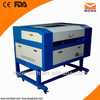MORN low cost plastic laser cutting machine