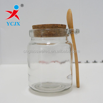 decorative clear round glass spice/gift bottle with cork and wood spoon