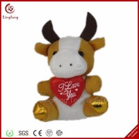 Factory customized plush cow with a red heart stuffed cow toy soft cartoon animal doll
