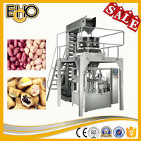 Supply of high accuracy rotary pre pouch flat bottom bag counting full automatic Dry Mango Fruit Carousel type Packaging Machine