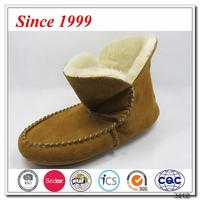 Cheap wholesale indoor sheepskin woman winter boot with button,ski boot slipper