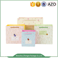 Custom made gift packing paper bags with handle