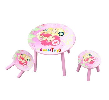 Children's round wooden table and chairs set used for preschool and kindergarten or home