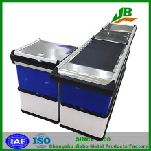 checkout counter with conveyor belt used in supermarket