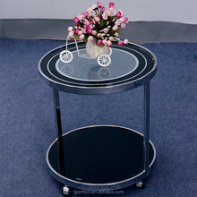 Promotion perfect living room modern high gloss acrylic rotating glass coffee table with wheels
