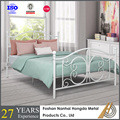Antique white metal bed