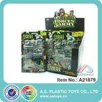 Soldier with plastic army toy guns