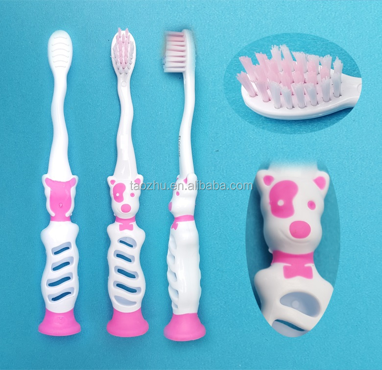 Children wall standing up spotty dog shape cartoon toothbrush with bottom suction cup