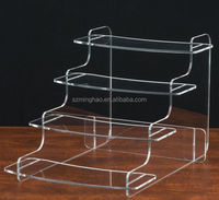 Tiered acrylic step risers with 4 platform