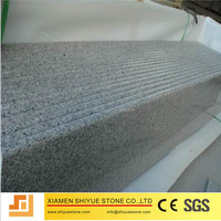 Polished granite tile interior stair treads