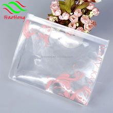 Wholesale clear soft vinyl pvc cosmetic zipper pouch/Plastic standing pvc zipper pouch bag with tear notch for snack