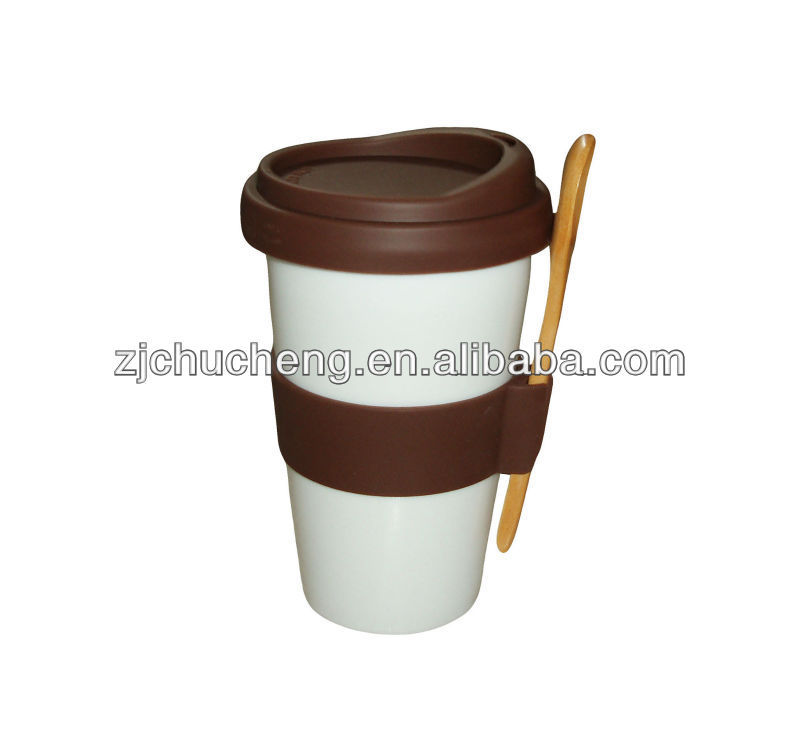White Ceramic Coffee Cup With Spoon And Silicone Sleeve