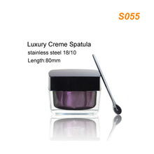 Luxury stainless steel cosmetic cream spatula along with skincare cream jars