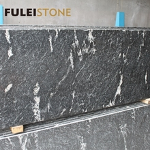 24x24 polished black cosmic granite tile with white veins