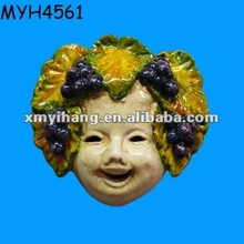 A sweet, handmade and hand painted Italian ceramic mask adorned with grapes