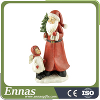 Polyresin christmas santa crafts for kids holding tree with girl beside on snow base