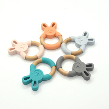 Silicone and beech wood teething animal rattle