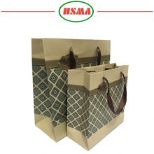 Bottom price round handles paper bag different types black shopping paper bag for clothing