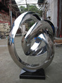 Abstract high polished stainless steel outdoor sculpture