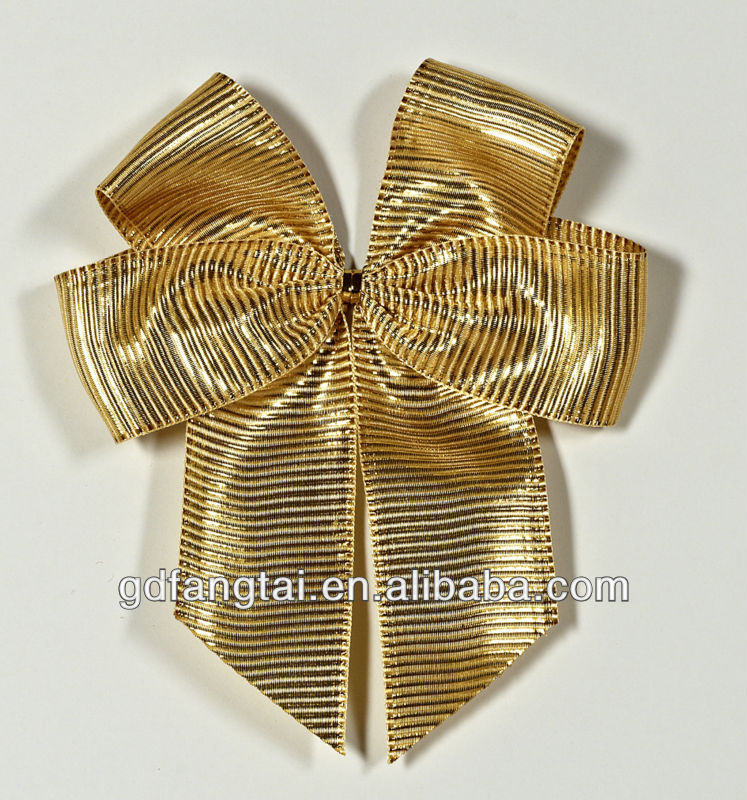 Golden gift box with pink ribbon tie
