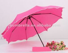 three folding Rain or shine pink umbrella