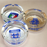 Round glass ashtray with football team decal