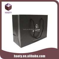 Black shiny packaging paper bag with ribbon tie