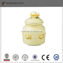 Yellow porcelain jar with fish lid