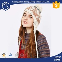 Trendy embroidered women winter knit hats with ear flaps