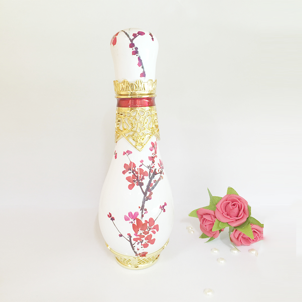 Sakura image oil perfume bottle wholesale with carved metal neck designs
