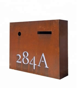 antique rusty outdoor letter holder with house number