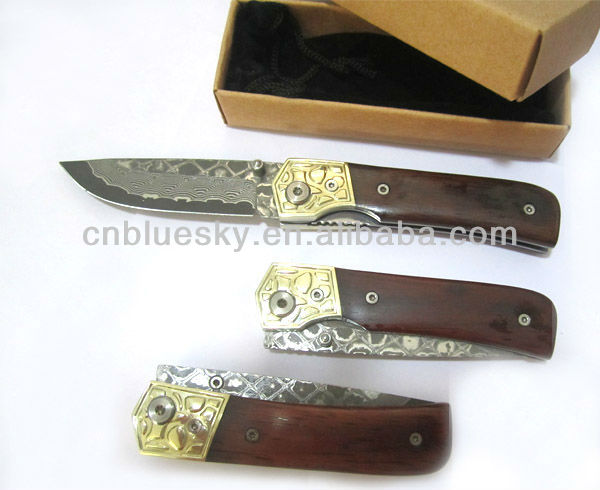 liner lock folding damascus knife