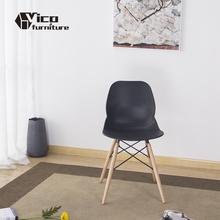 wholesale best price hot selling black plastic seat wooden leg living room designer chair