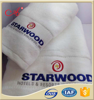 woven technics and embroidered cotton hotel towel