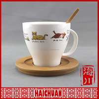 Face design ceramic coffee cup with wooden saucer and spoon