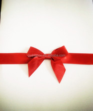 3/4inch wide ribbon with 3 inches tied satin pre-tied ribbon bows with a gold twist to wrap.