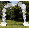 White handmade paper flower wedding arch