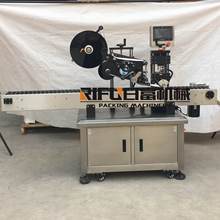 Automatic horizontal tube labeling machine