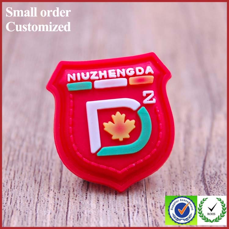 Private indonesia red shield shape pvc label for suitcase flannel shirt