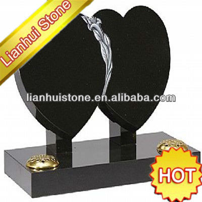 upright black double heart headstone