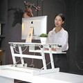 Height adjustable stand up desk with keyboard tray