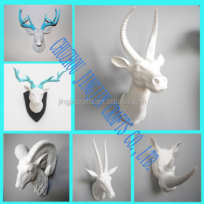 artificial resin deer animal skull in white with gold antler