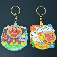 Wholesale bread superman pvc key ring/souvenir custom keychain/the transparent elliptic inflatable trinket keychain for kids