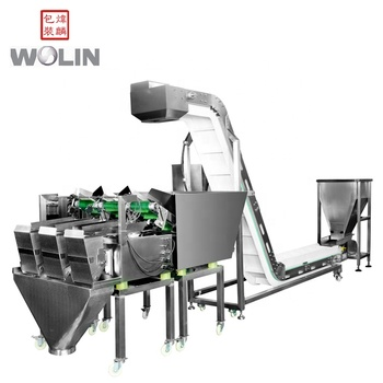 Three heads  weighing machine with inclined food-grade conveyor packing salad fresh vegetable fruits