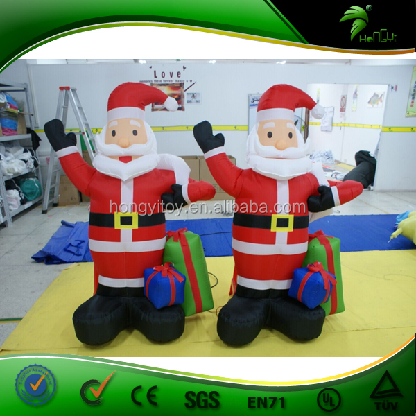 New Design mini inflatable santa claus,moving santa claus with gift