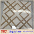 Beige marble floor tiles with cross golden lines waterjet
