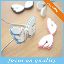 high quality micro injection 3d pvc rubber fashion wings shape plastic earphone cord winder