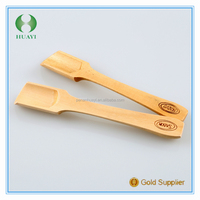 A Wooden Spoon Of Salt Bath;Honey spoon